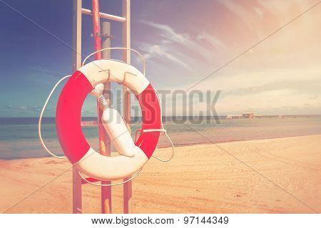 Lifebuoy, Life Preserver On Sandy Beach