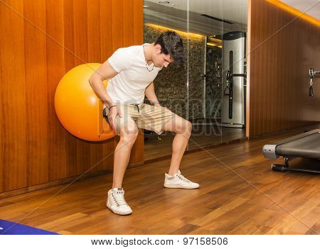 Handsome young man working out at gym