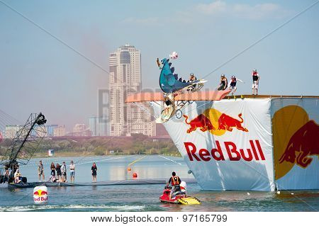 MOSCOW - JULY 26: Competitors perform a flight on Red Bull Flugtag on July 26, 2015 in Moscow. Red Bull Flugtag is an event in which competitors attempt to fly homemade human-powered flying machines