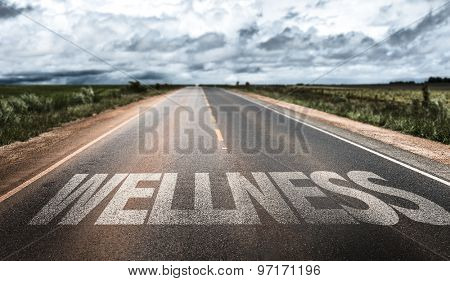 Wellness written on the road
