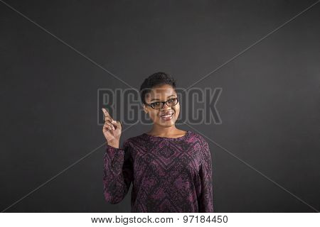 African Woman Good Idea On Blackboard Background