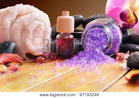 Bath Salts And Oils On Wooden Brown Background