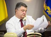 KIEV UKRAINE - Jun 23 2015: President of Ukraine Petro Poroshenko held a telephone conversation with German Chancellor Angela Merkel French President Francois Hollande and Russian President Putin poster