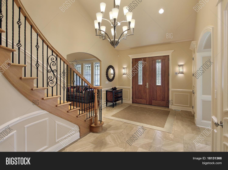 Foyer luxury home curved staircase image photo bigstock for Escaleras de casas de lujo