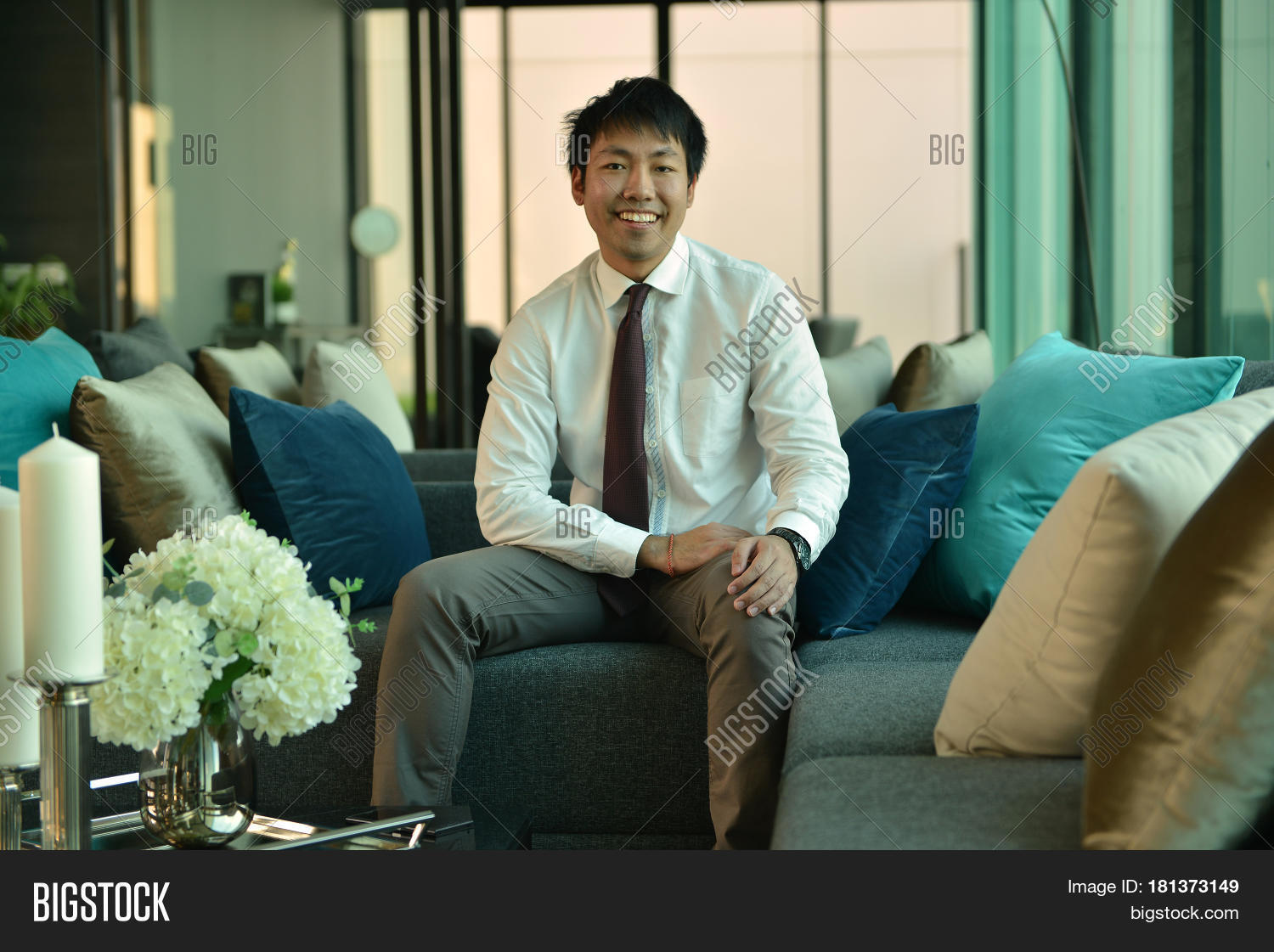 An Asian Business Man Sitting In Luxury Lobby In Hotel, Person