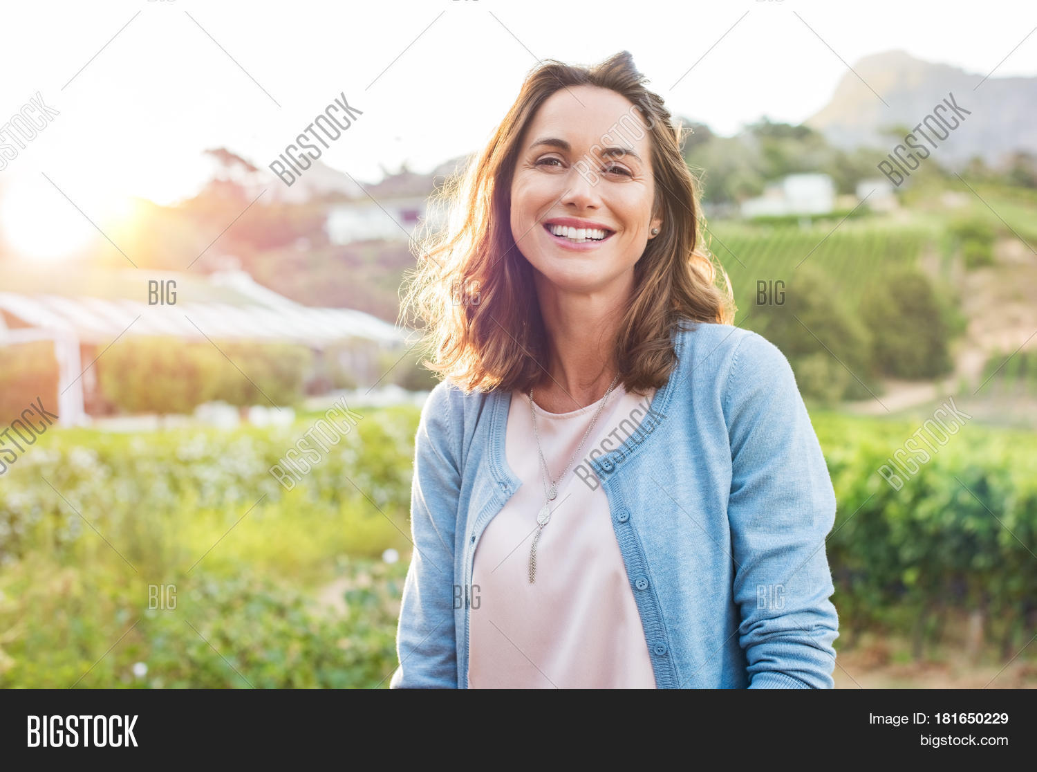 cheerful mature woman enjoying park image & photo | bigstock