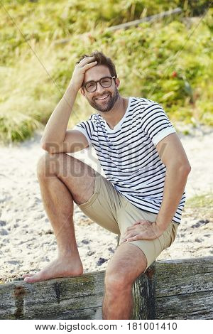 Beach dude relaxing in shorts and t-shirt portrait