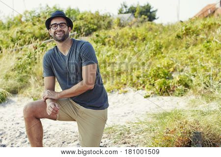 Happy guy on beach looking at camera