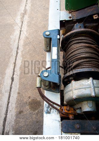 Old sling cable of electric winch in front of 4x4 car