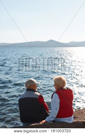 Serene senior couple talking and relaxing in natural environment