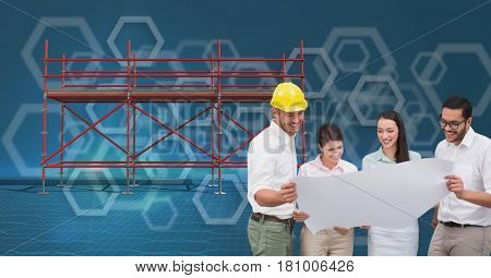 Digital composite of A group of architects looking a blueprint and 3D scaffolding with blue background