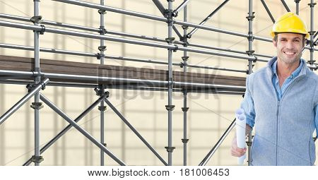 Digital composite of happy architect in front of 3D scaffolding