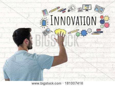 Digital composite of Man touching Innovation text with drawings graphics