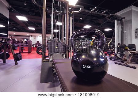 Kettlebell on  background of a simulator in the gym. Interior.
