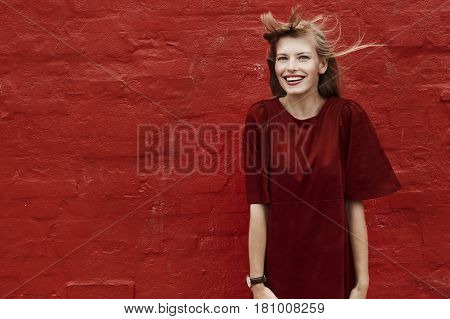 Portrait of beautiful woman in red dress smiling