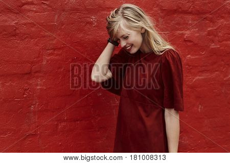 Beautiful fashion model in red dress smiling