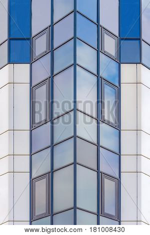 background texture. glass facade of a modern high-rise building
