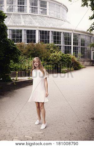 Botanical garden beautiful woman in summer dress portrait