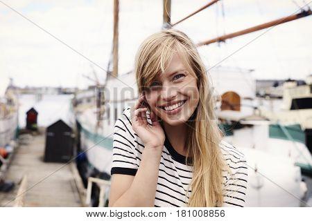 Stunning blue eyed sailor blond woman portrait