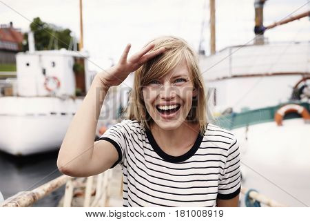 Beautiful woman saluting to camera laughing outdoor
