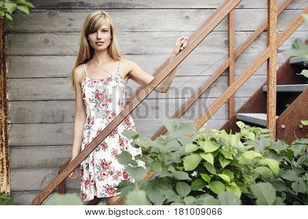 Girl in summer dress looking at camera