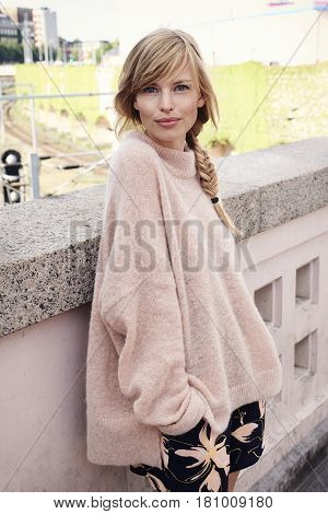 Gorgeous woman in pink fashion portrait in the city