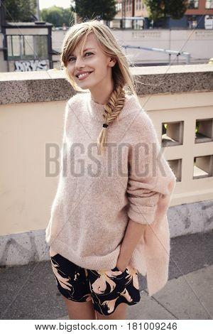 Pretty woman in pink fashion portrait in the city