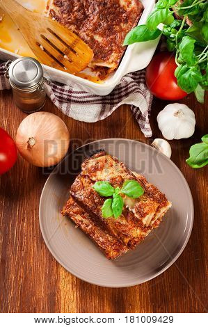 Baked Cannelloni With Minced Meat And Bechamel Sauce On A Plate