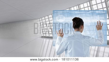 Digital composite of Doctor ( woman) using futuristic tactile screen at the hospital
