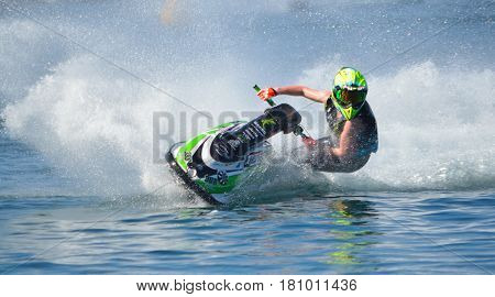 WYBOSTON, BEDFORDSHIRE, ENGLAND -  APRIL 09, 2017: Jet Ski  cornering at speed creating at lot of spray.