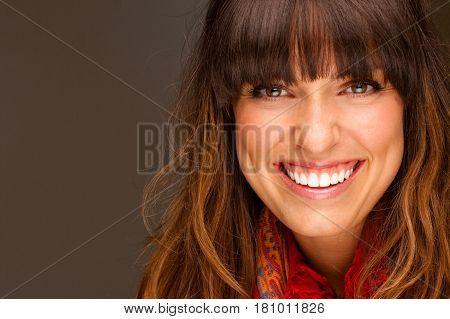 Beautiful young happy woman with a friendly smile.