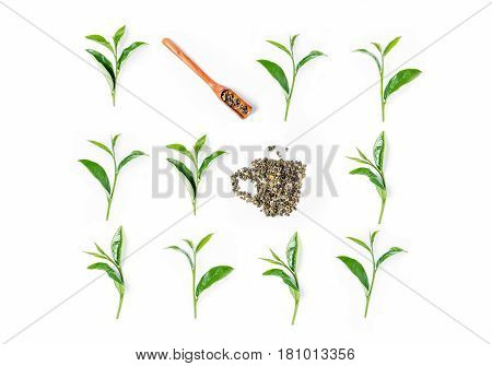 Tea Leaves And Wooden Scoop On White Background. Top View