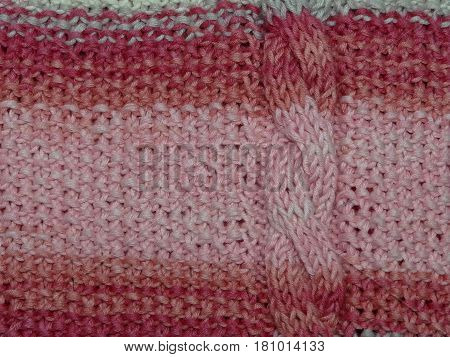 beautiful knit fabric with red and beige tones, closeup