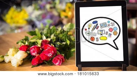 Digital composite of Various icons on digital tablet by flowers on table