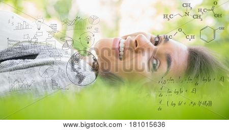 Digital composite of Digital composite image of happy woman lying on grass with equations
