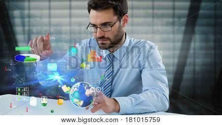 Digital composite of Digital composite image of businessman touching icons at desk
