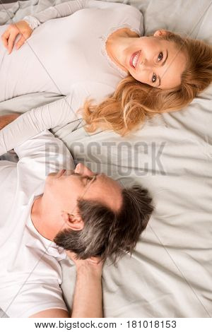 Top View Of Beautiful Happy Mature Couple Lying In Bed