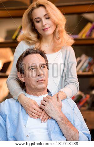 Beautiful Smiling Blonde Woman Hugging Pensive Mature Man