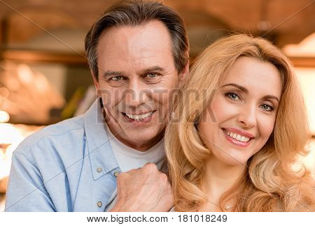 Close-up Portrait Of Beautiful Happy Mature Couple Looking At Camera