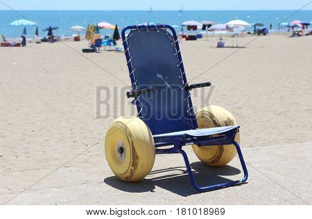 Wheelchair With Large Inflatable Wheels To Go In The Sea