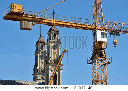 Tower Crane in Construction site close to old catholic church
