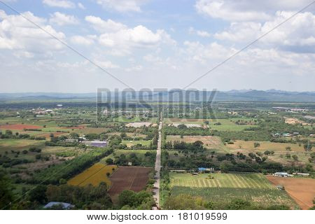 landscape frome above mountain view of agriculture life and road with sky in summer thailand