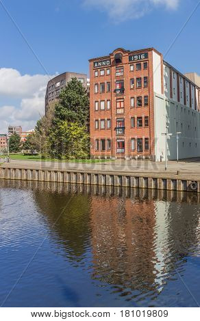 Old warehouse with reflection in the water in Groningen Holland