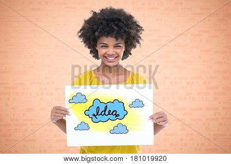 Digital composite of Portrait of smiling woman holding drawing of clouds representing ideas