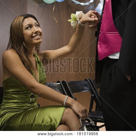 Hispanic teenaged girl smiling at boyfriend