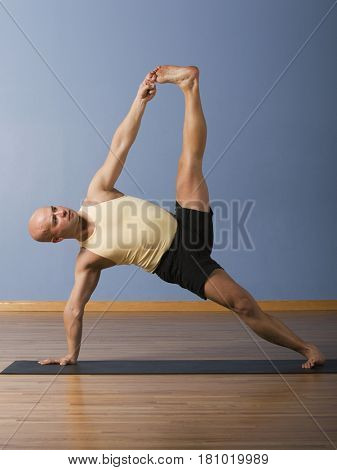 Hispanic man practicing yoga