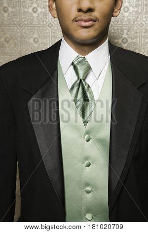 Hispanic man wearing suit