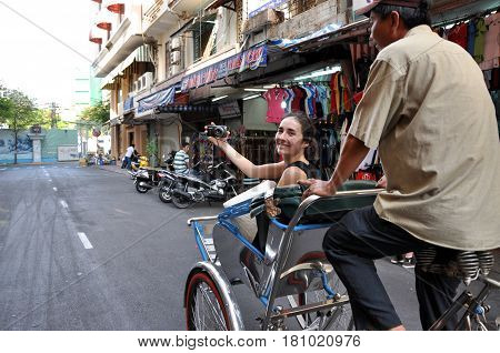 Tourist Taking A Tour With A Classic Vietnamese Rickshaw, Tuk Tuk