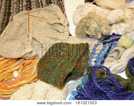 many handmade crafts from expert seamstress with knitting needles and wool