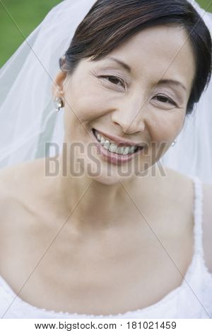 Close up of Asian bride smiling